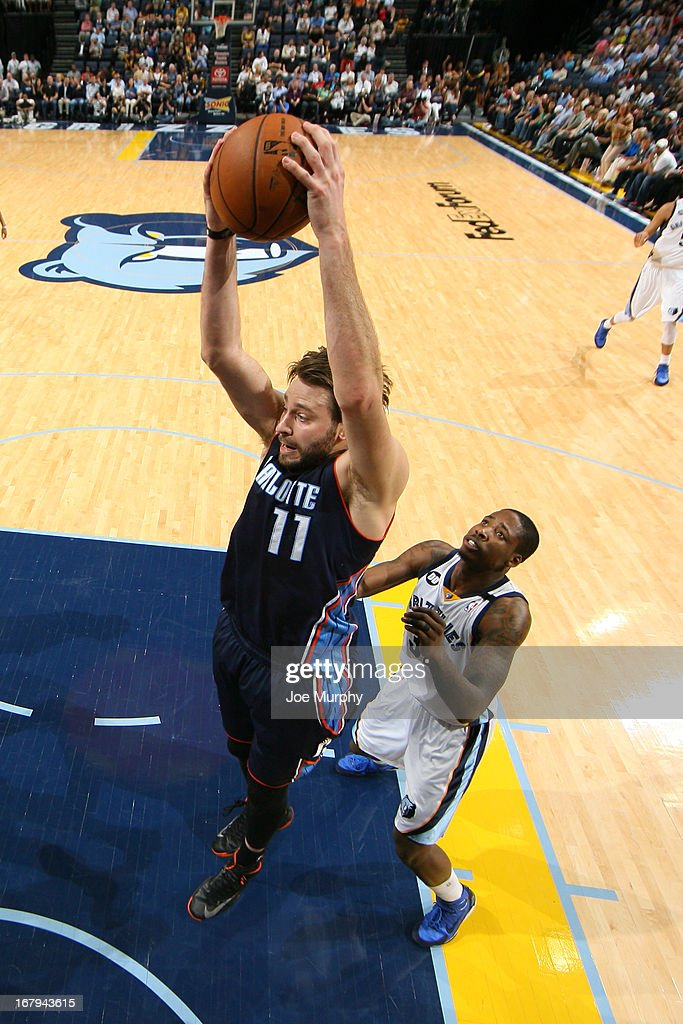 <a gi-track='captionPersonalityLinkClicked' href=/galleries/search?phrase=Josh+McRoberts+-+Basketball+Player&family=editorial&specificpeople=732530 ng-click='$event.stopPropagation()'>Josh McRoberts</a> #11 of the Charlotte Bobcats grabs a rebound against Ed Davis #32 of the Memphis Grizzlies on April 9, 2013 at FedExForum in Memphis, Tennessee.