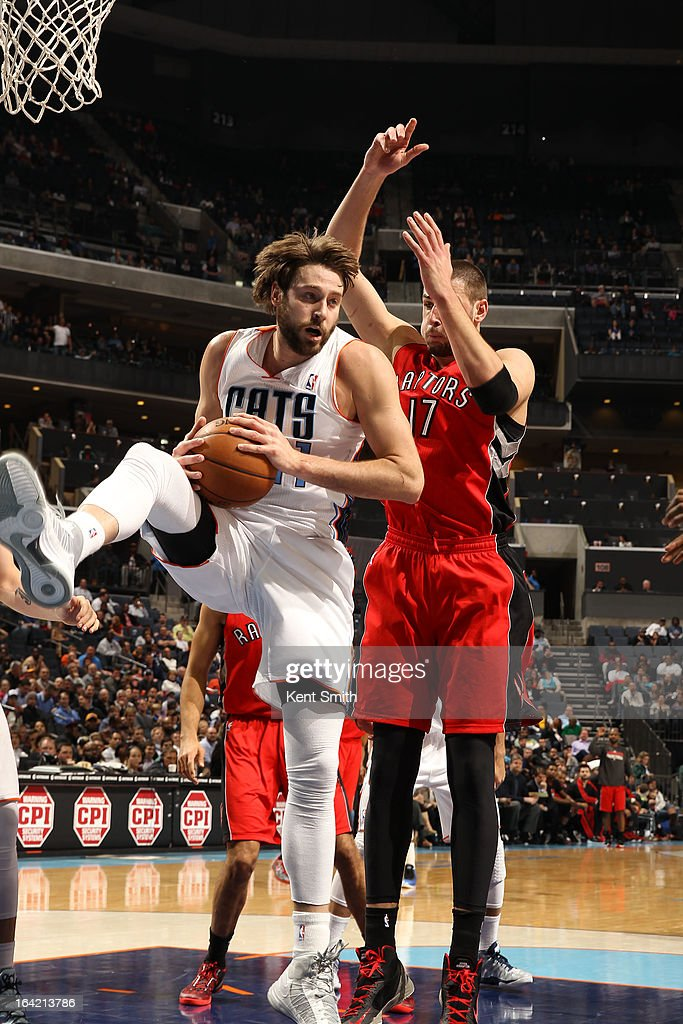 Josh McRoberts #11 of the Charlotte Bobcats grabs a rebound against Jonas Valanciunas #17 of the Toronto Raptors at the Time Warner Cable Arena on March 20, 2013 in Charlotte, North Carolina.