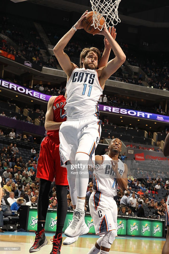 <a gi-track='captionPersonalityLinkClicked' href=/galleries/search?phrase=Josh+McRoberts&family=editorial&specificpeople=732530 ng-click='$event.stopPropagation()'>Josh McRoberts</a> #11 of the Charlotte Bobcats grabs a rebound against the Toronto Raptors at the Time Warner Cable Arena on March 20, 2013 in Charlotte, North Carolina.