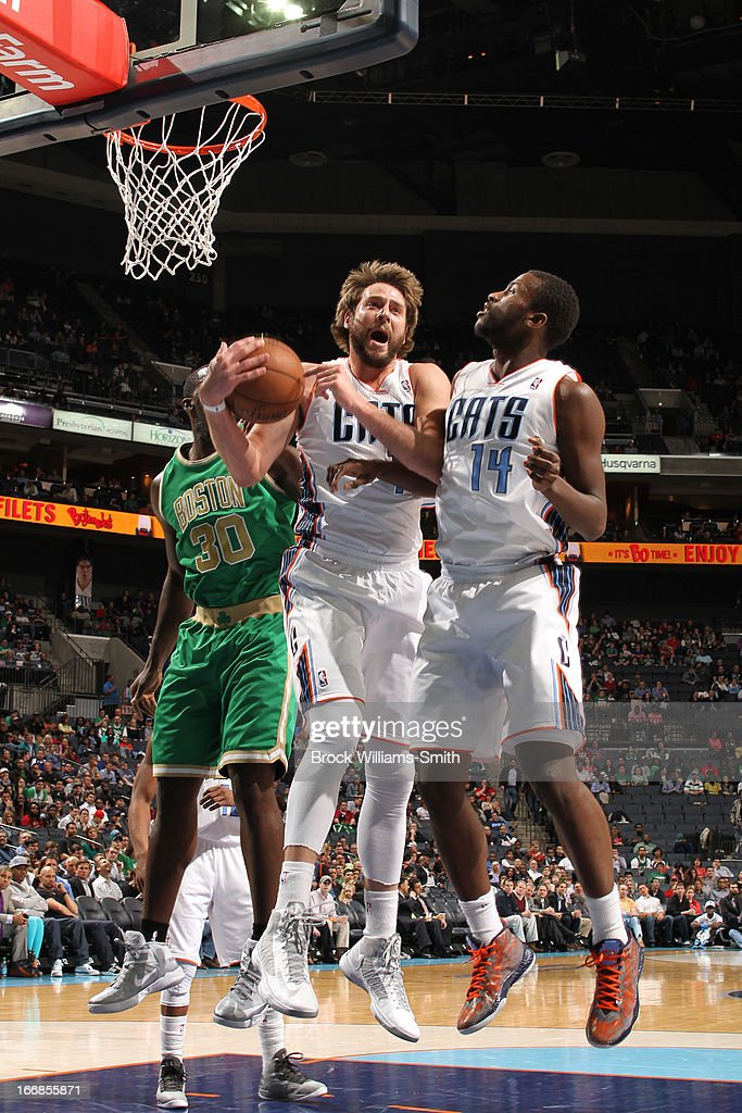Josh McRoberts #11 of the Charlotte Bobcats grabs the rebound in mid-air against the Boston Celtics at the Time Warner Cable Arena on March 12, 2013 in Charlotte, North Carolina.