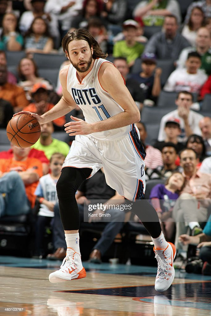 Josh McRoberts #11 of the Charlotte Bobcats handles the ball against the Portland Trail Blazers during the game at the Time Warner Cable Arena on March 22, 2014 in Charlotte, North Carolina.