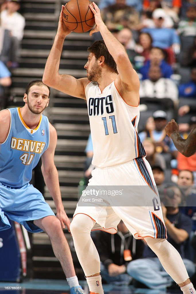Josh McRoberts #11 of the Charlotte Bobcats looks to drive to the basket against the Denver Nuggets at the Time Warner Cable Arena on February 23, 2013 in Charlotte, North Carolina.