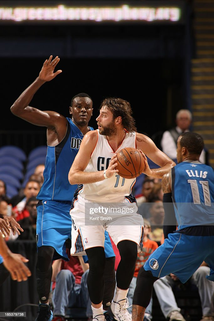 <a gi-track='captionPersonalityLinkClicked' href=/galleries/search?phrase=Josh+McRoberts&family=editorial&specificpeople=732530 ng-click='$event.stopPropagation()'>Josh McRoberts</a> #11 of the Charlotte Bobcats looks to pass the ball against the Dallas Mavericks at the Greensboro Coliseum on October 19, 2013 in Greensboro, North Carolina.