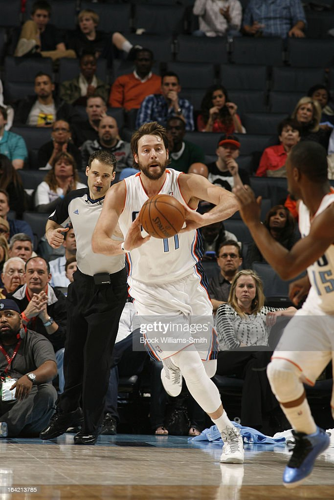 Josh McRoberts #11 of the Charlotte Bobcats passes the ball up-court against the Toronto Raptors at the Time Warner Cable Arena on March 20, 2013 in Charlotte, North Carolina.