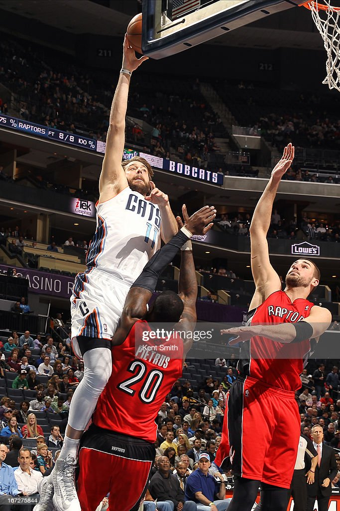 <a gi-track='captionPersonalityLinkClicked' href=/galleries/search?phrase=Josh+McRoberts&family=editorial&specificpeople=732530 ng-click='$event.stopPropagation()'>Josh McRoberts</a> #11 of the Charlotte Bobcats puts up a shot against the Toronto Raptors at the Time Warner Cable Arena on March 20, 2013 in Charlotte, North Carolina.