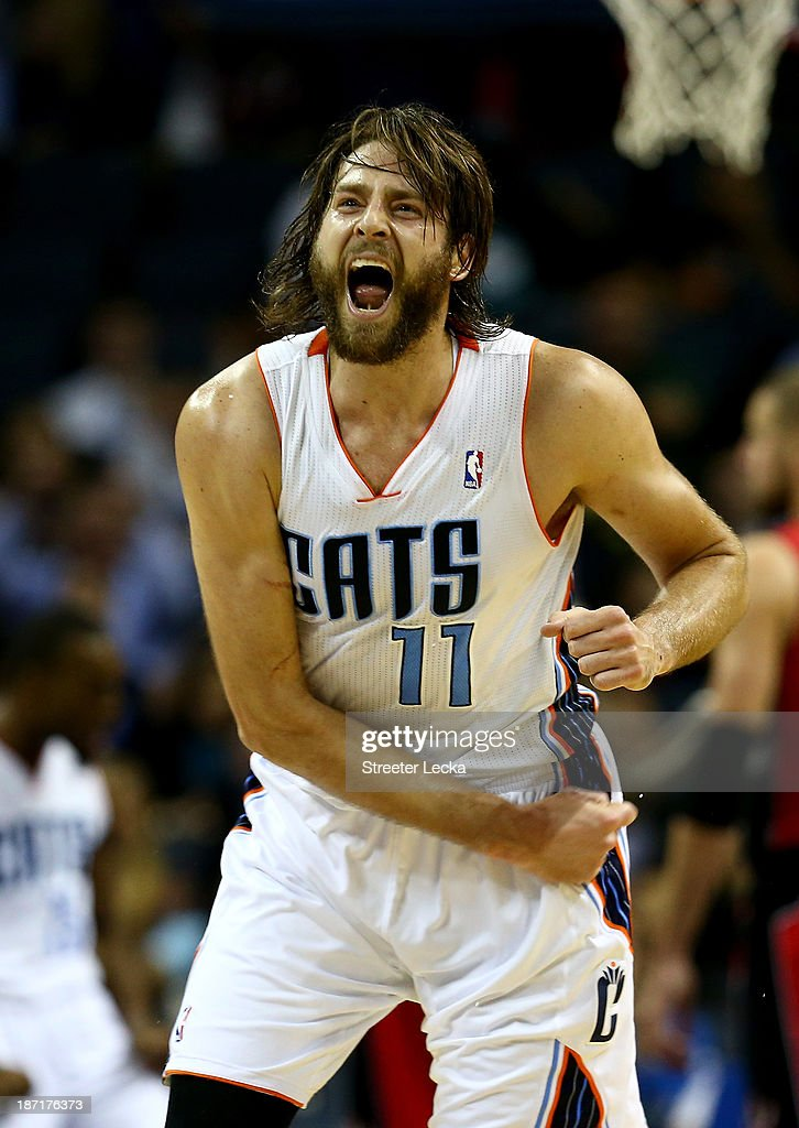 <a gi-track='captionPersonalityLinkClicked' href=/galleries/search?phrase=Josh+McRoberts&family=editorial&specificpeople=732530 ng-click='$event.stopPropagation()'>Josh McRoberts</a> #11 of the Charlotte Bobcats reacts after a play during their game against the Toronto Raptors at Time Warner Cable Arena on November 6, 2013 in Charlotte, North Carolina.