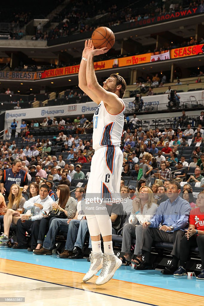 Josh McRoberts #11 of the Charlotte Bobcats shoots a three pointer against the Cleveland Cavaliers at the Time Warner Cable Arena on April 17, 2013 in Charlotte, North Carolina.