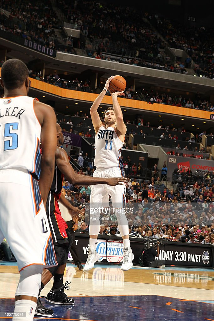 Josh McRoberts #11 of the Charlotte Bobcats shoots against the Miami Heat at the Time Warner Cable Arena on April 5, 2013 in Charlotte, North Carolina.