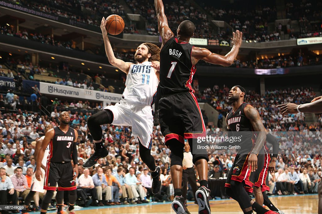 Josh McRoberts #11 of the Charlotte Bobcats shoots against the Miami Heat in Game Four of the Eastern Conference Quarterfinals in the 2014 NBA Playoffs at the Time Warner Cable Arena on April 28, 2014 in Charlotte, North Carolina.