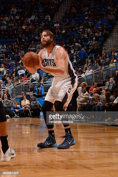 Josh McRoberts of the Charlotte Bobcats shoots against the Orlando Magic on January 17 2014 at Amway Center in Orlando Florida NOTE TO USER User...