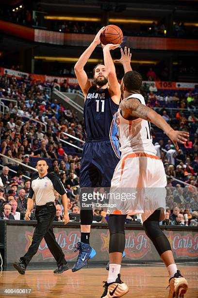 Josh McRoberts of the Charlotte Bobcats shoots against the Phoenix Suns on February 1 2014 at US Airways Center in Phoenix Arizona NOTE TO USER User...