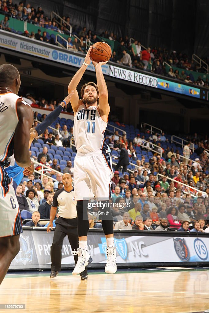 <a gi-track='captionPersonalityLinkClicked' href=/galleries/search?phrase=Josh+McRoberts&family=editorial&specificpeople=732530 ng-click='$event.stopPropagation()'>Josh McRoberts</a> #11 of the Charlotte Bobcats shoots the jump shot against the Dallas Mavericks at the Greensboro Coliseum on October 19, 2013 in Greensboro, North Carolina.