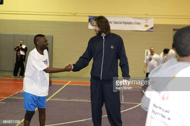 Josh McRoberts of the Charlotte Bobcats spend time with the kids from the Special Olympics at the Carole Heofner Center on April 7 2014 in Charlotte...
