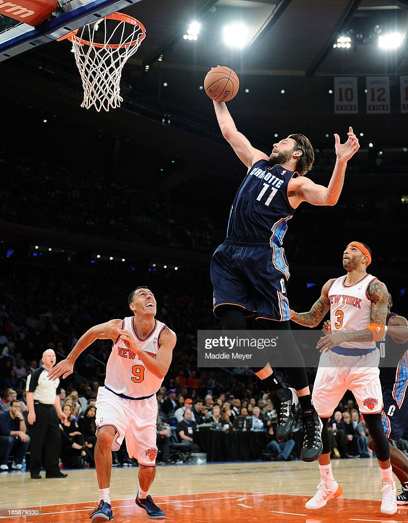 <a gi-track='captionPersonalityLinkClicked' href=/galleries/search?phrase=Josh+McRoberts&family=editorial&specificpeople=732530 ng-click='$event.stopPropagation()'>Josh McRoberts</a> #11 of the Charlotte Bobcats takes a shot against the New York Knicks during the first half of preseason play at Madison Square Garden on October 25, 2013 in New York City.