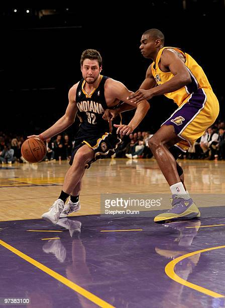 Josh McRoberts of the Indiana Pacers drives around Andrew Bynum of the Los Angeles Lakers on March 2 2010 at Staples Center in Los Angeles California...