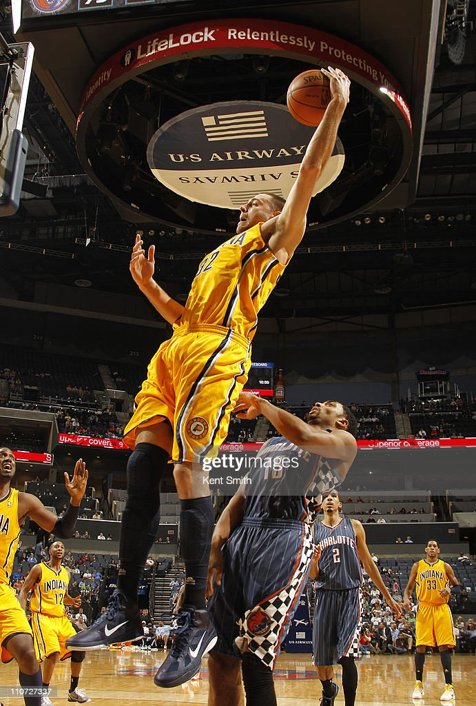 Josh McRoberts #32 of the Indiana Pacers grabs a rebound against the Charlotte Bobcats on March 23, 2011 at Time Warner Cable Arena in Charlotte, North Carolina.