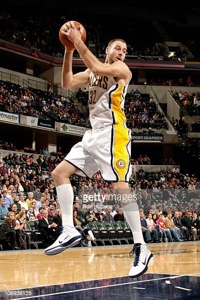 Josh McRoberts of the Indiana Pacers grabs a rebound during the game against the Houston Rockets on November 12 2010 at Conseco Fieldhouse in...