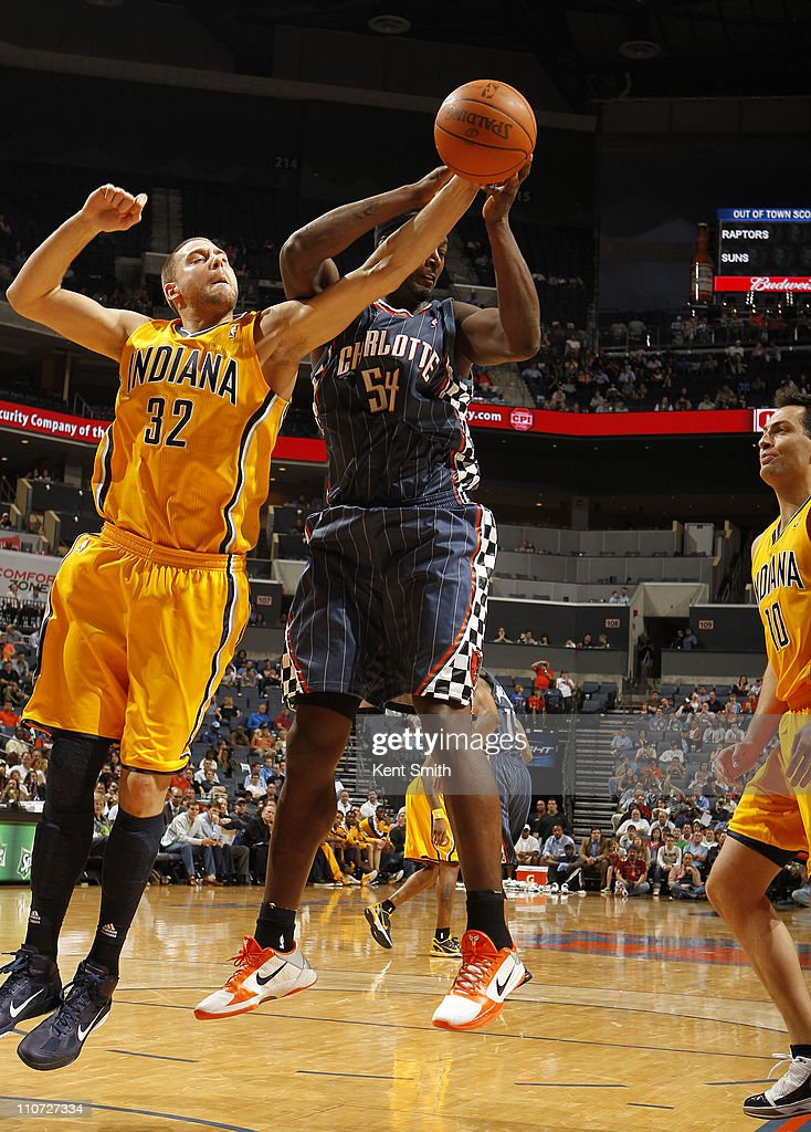 Josh McRoberts #32 of the Indiana Pacers grabs a rebound from Kwame Brown #54 of the Charlotte Bobcats on March 23, 2011 at Time Warner Cable Arena in Charlotte, North Carolina.