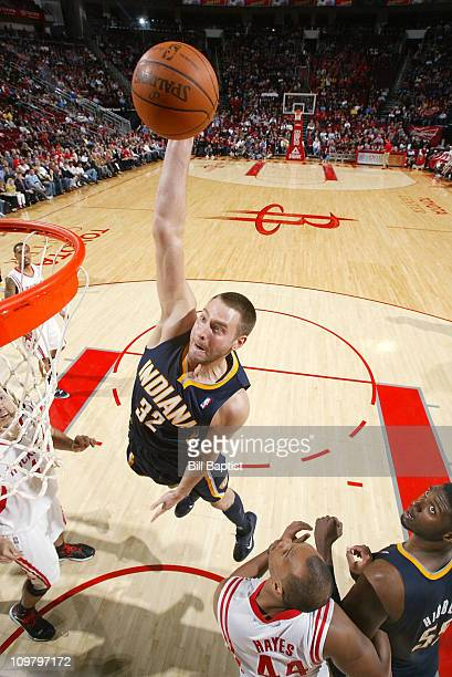 Josh McRoberts of the Indiana Pacers shoots the ball over Chuck Hayes of the Houston Rockets on March 5 2011 at the Toyota Center in Houston Texas...