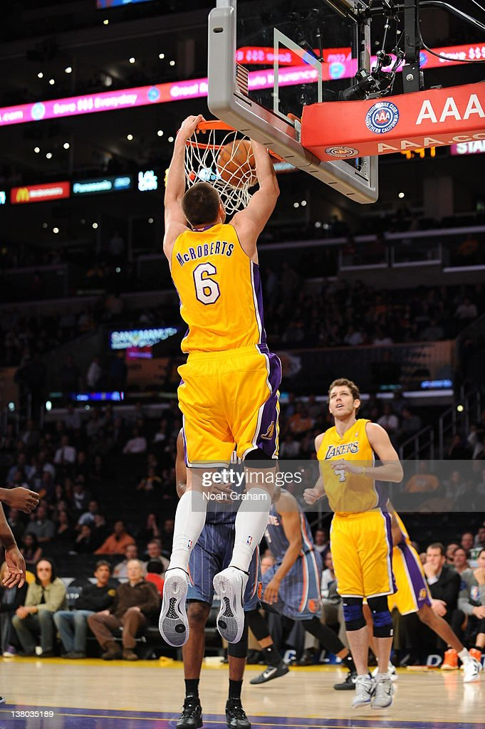 Josh McRoberts #6 of the Los Angeles Lakers goes to the basket during the game between the Los Angeles Lakers and the Charlotte Bobcats at Staples Center on January 31, 2012 in Los Angeles, California.