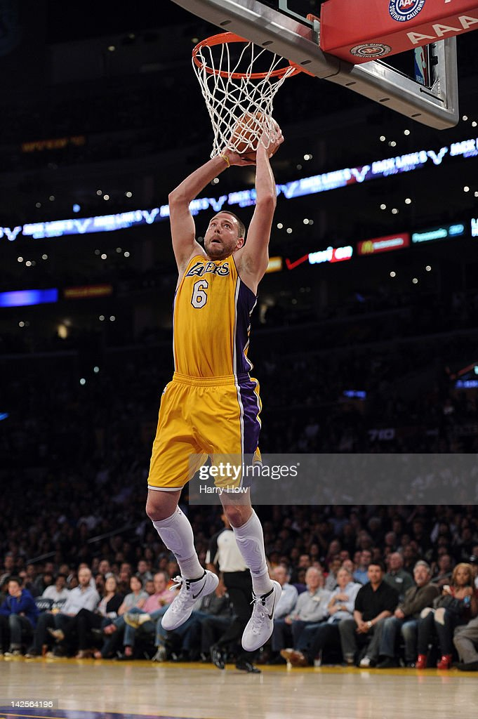 <a gi-track='captionPersonalityLinkClicked' href=/galleries/search?phrase=Josh+McRoberts+-+Basketball+Player&family=editorial&specificpeople=732530 ng-click='$event.stopPropagation()'>Josh McRoberts</a> #6 of the Los Angeles Lakers scores on a dunk against the Houston Rockets at Staples Center on April 6, 2012 in Los Angeles, California.