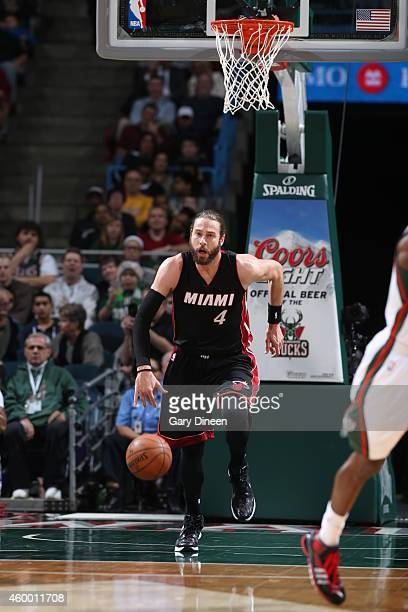 Josh McRoberts of the Miami Heat brings the ball up court against the Milwaukee Bucks on December 5 2014 at the BMO Harris Bradley Center in...