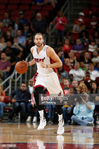 Josh McRoberts of the Miami Heat brings the ball up court against the Orlando Magic during a preseason game on October 7 2015 at KFC Yum Center in...