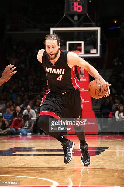 Josh McRoberts of the Miami Heat drives against the Washington Wizards at the Verizon Center on December 1 2014 in Washington DC NOTE TO USER User...