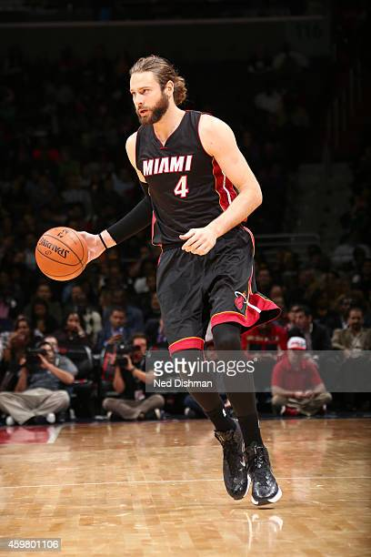 Josh McRoberts of the Miami Heat drives to the basket against the Washington Wizards during the game on December 1 2014 at Verizon Center in...