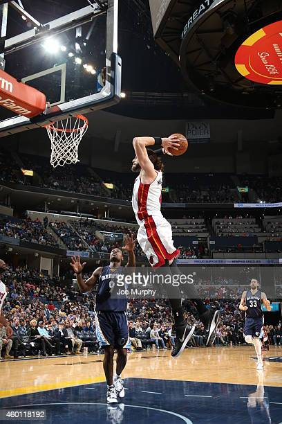 Josh McRoberts of the Miami Heat goes up for a dunk against the Memphis Grizzlies during the game on December 7 2014 at FedExForum in Memphis...