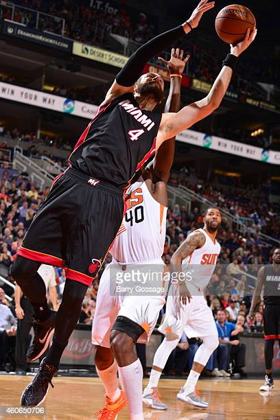 Josh McRoberts of the Miami Heat grabs a rebound against the Phoenix Suns on December 9 2014 at US Airways Center in Phoenix Arizona NOTE TO USER...