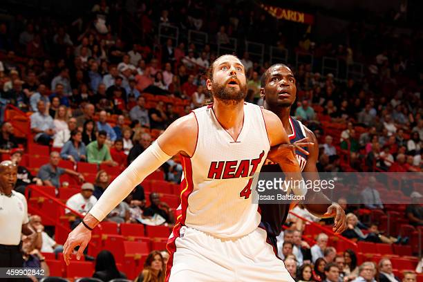 Josh McRoberts of the Miami Heat looks for the ball against the Atlanta Hawks during the game on December 3 2014 at American Airlines Arena in Miami...