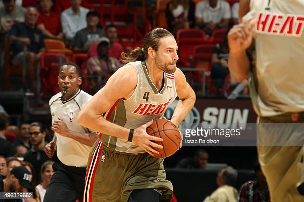 Josh McRoberts of the Miami Heat passes the ball against the Toronto Raptors during the game on November 8 2015 at American Airlines Arena in Miami...