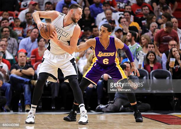 Josh McRoberts of the Miami Heat posts up Jordan Clarkson of the Los Angeles Lakers during a game at American Airlines Arena on December 22 2016 in...