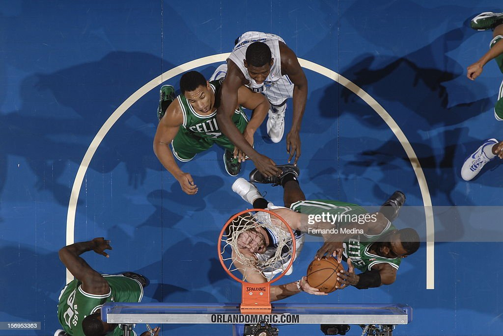 Josh McRoberts #17 of the Orlando Magic and Jeff Green #8 of the Boston Celtics battle for the ball control during the game between the Boston Celtics and the Orlando Magic on November 25, 2012 at Amway Center in Orlando, Florida.