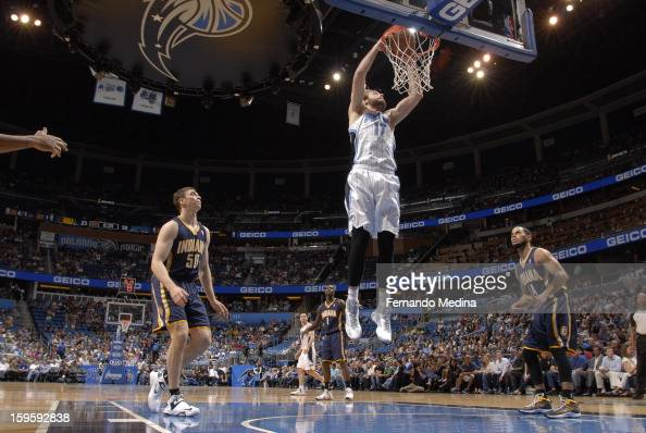 Josh McRoberts of the Orlando Magic dunks the ball against the Indiana Pacers during the game on January 16 2013 at Amway Center in Orlando Florida...