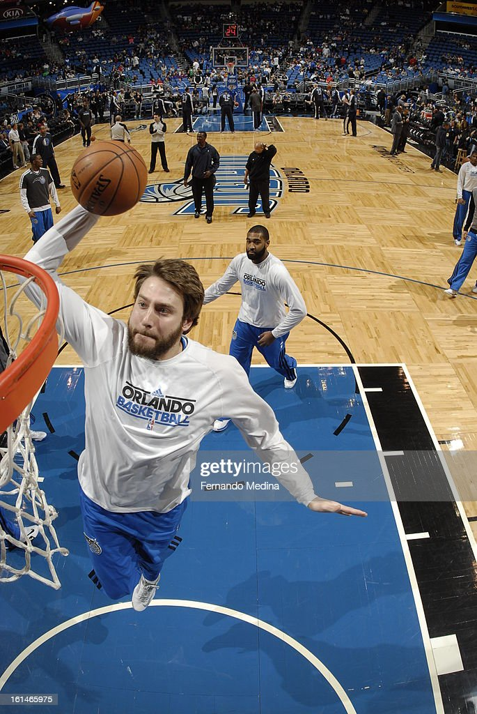 <a gi-track='captionPersonalityLinkClicked' href=/galleries/search?phrase=Josh+McRoberts+-+Basketball+Player&family=editorial&specificpeople=732530 ng-click='$event.stopPropagation()'>Josh McRoberts</a> #19 of the Orlando Magic goes up for a during a pre-game dunk against the Dallas Mavericks during the game on January 20, 2013 at Amway Center in Orlando, Florida.