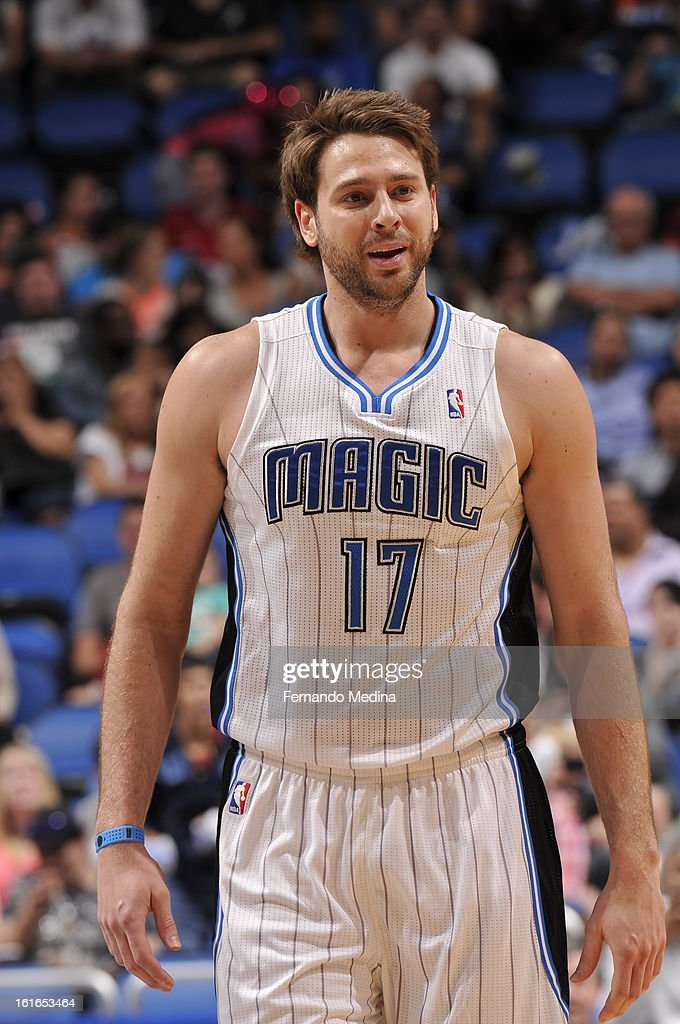 Josh McRoberts #17 of the Orlando Magic smiles and walk backs up the court against the Atlanta Hawks during the game on February 13, 2013 at Amway Center in Orlando, Florida.