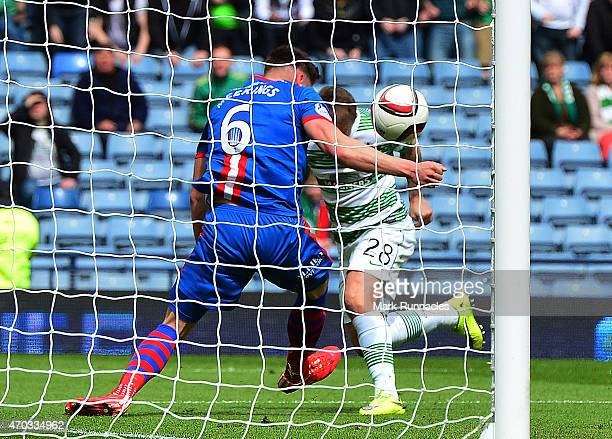 Josh Meekings of Caledonian Thistle apparently handles the ball on the goal line from Leigh Griffiths of Celtic during the William Hill Scottish Cup...