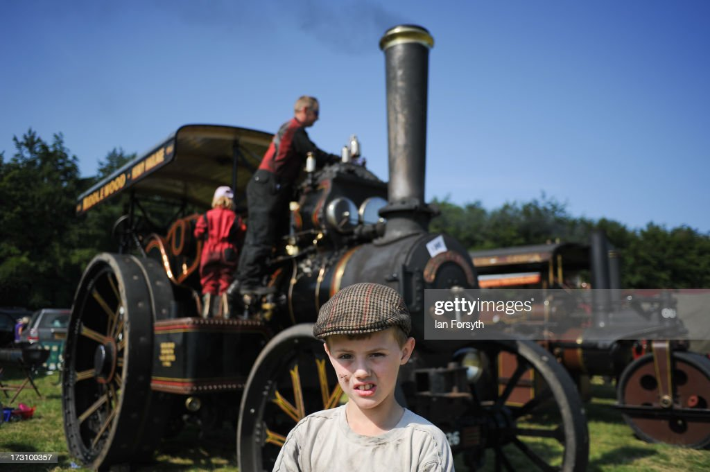 Josh Middlewood, 11 from Driffield in Yorkshire poses in front of his dads steam engine at the steam rally at Duncombe Park on July 7, 2013 in Helmsley, England. The popular steam rally takes place in the magnificent surroundings of the park over the first weekend in July each year and brings together traction engines, working displays, vintage tractors, commercial and military vehicles and vintage cars.