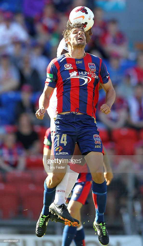 Josh Mitchell of the Jets contests the header against Heart defence during the round seven A-League match between the Newcastle Jets and the Melbourne Heart at Hunter Stadium on November 24, 2013 in Newcastle, Australia.