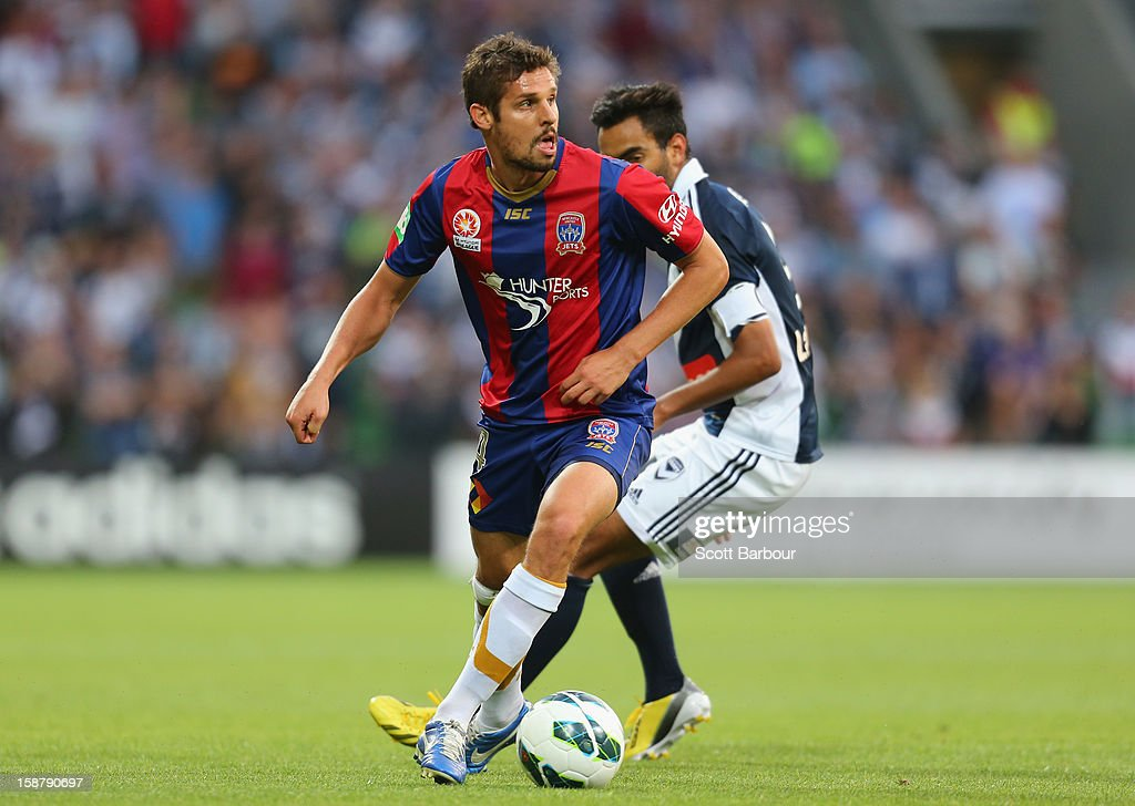 Josh Mitchell of the Jets controls the ball during the round 13 A-League match between the Melbourne Victory and the Newcastle Jets at AAMI Park on December 28, 2012 in Melbourne, Australia.