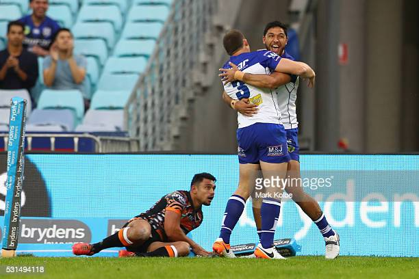 Josh Morris and Curtis Rona celebrate Curtis Rona scoring a try during the round 10 NRL match between the Wests Tigers and the Canterbury Bulldogs at...