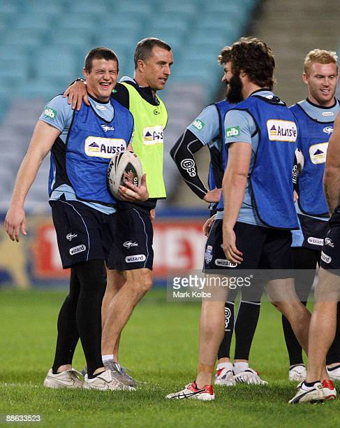 Josh Morris and David Williams share a laugh during the warmup ahead of a New South Wales Blues training session at ANZ Stadium on June 23 2009 in...