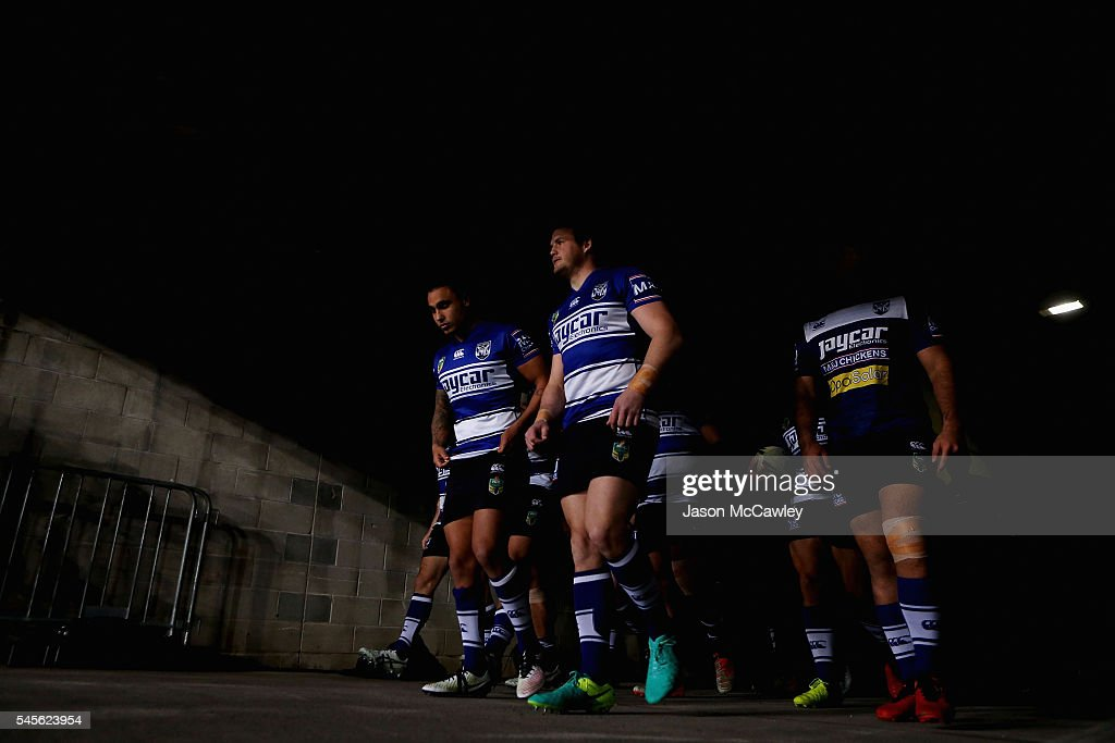 Josh Morris and Michael Lichaa of the Bulldogs make their way to the field to warm up before to the round 18 NRL match between the Canterbury Bulldogs and the Wests Tigers at ANZ Stadium on July 9, 2016 in Sydney, Australia.