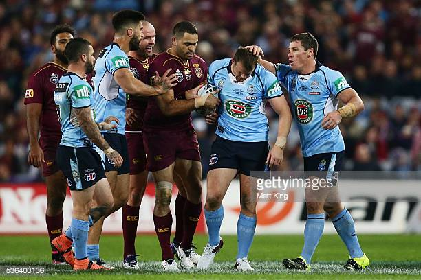 Josh Morris of the Blues looks dejected after dropping the ball during game one of the State Of Origin series between the New South Wales Blues and...