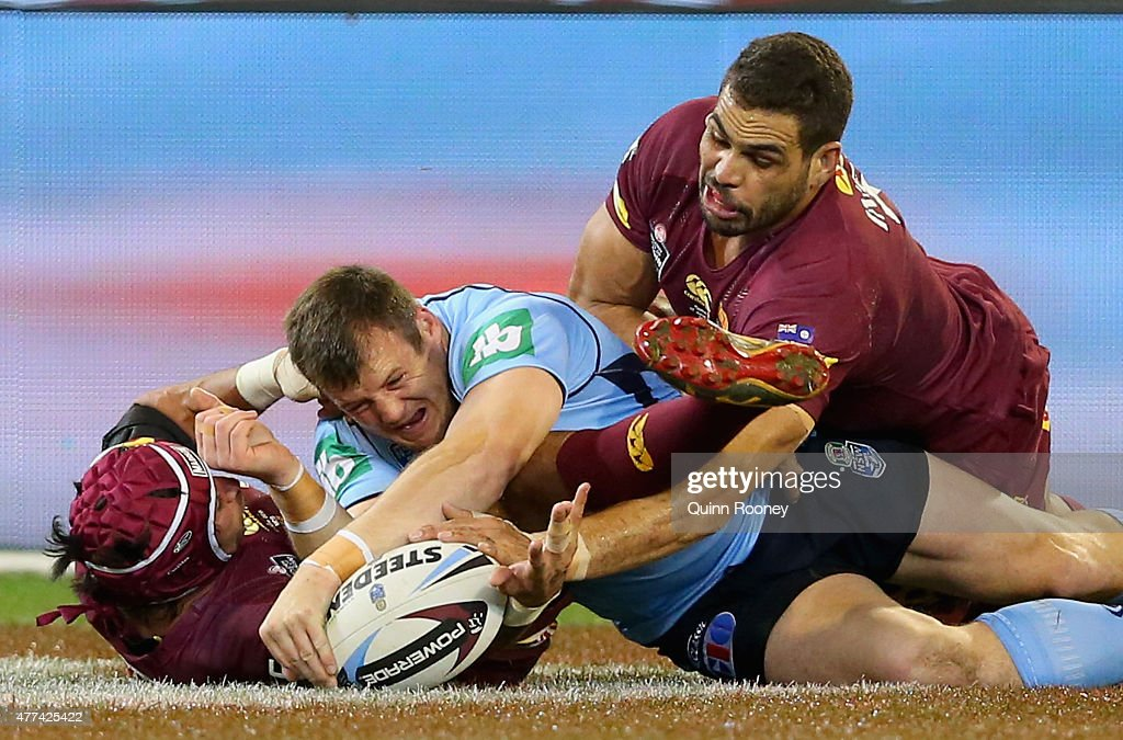 Josh Morris of the Blues scores a try during game two of the State of Origin series between the New South Wales Blues and the Queensland Maroons at...