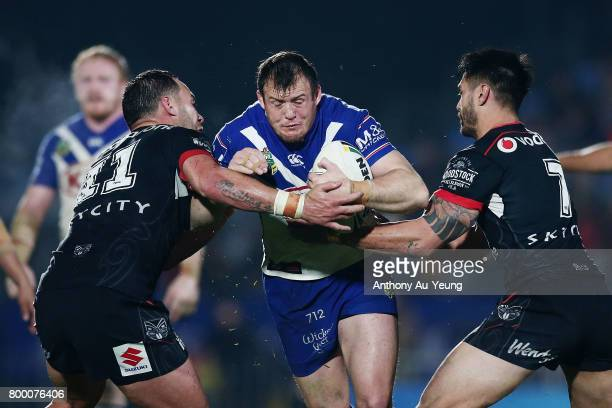 Josh Morris of the Bulldogs is tackled by Bodene Thompson of the Warriors during the round 16 NRL match between the New Zealand Warriors and the...