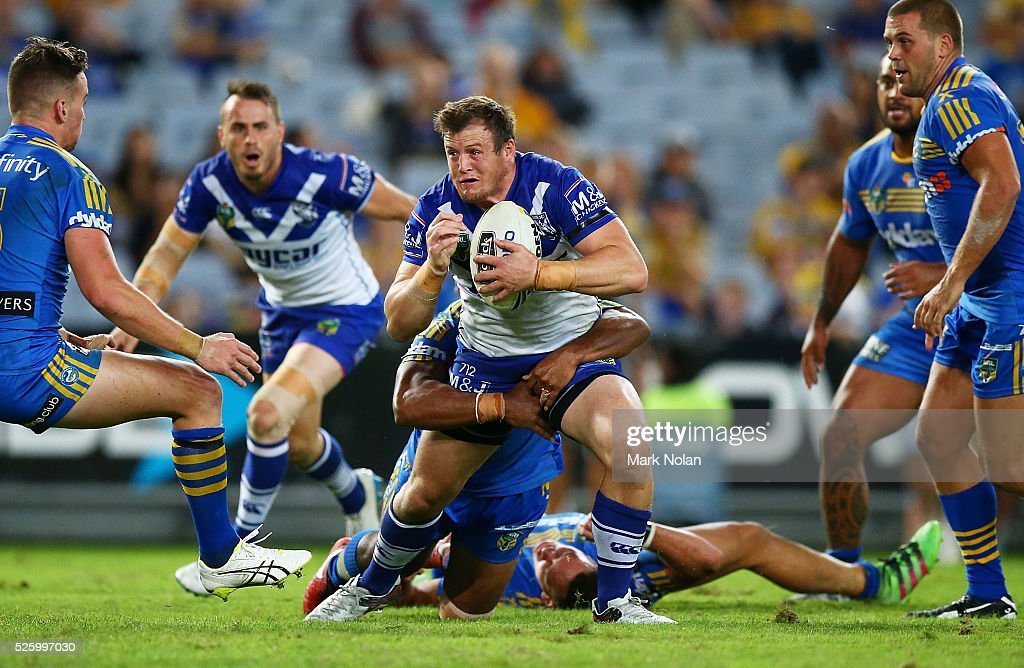 <a gi-track='captionPersonalityLinkClicked' href=/galleries/search?phrase=Josh+Morris+-+Rugby+Player&family=editorial&specificpeople=10980783 ng-click='$event.stopPropagation()'>Josh Morris</a> of the Bulldogs is tackled during the round nine NRL match between the Parramatta Eels and the Canterbury Bulldogs at ANZ Stadium on April 29, 2016 in Sydney, Australia.
