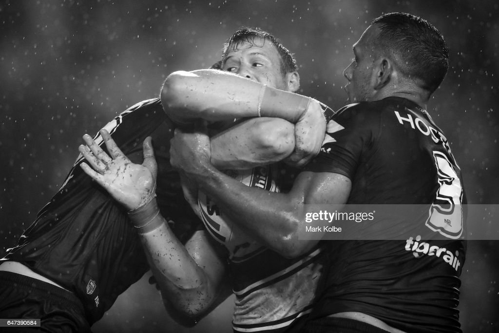 Josh Morris of the Bulldogs is tackled during the round one NRL match between the Canterbury Bulldogs and the Melbourne Storm at Belmore Sports Ground on March 3, 2017 in Sydney, Australia.